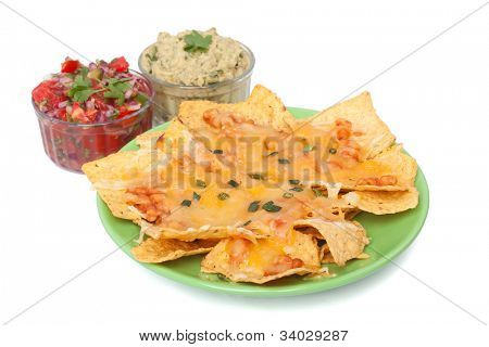 Tortilla chips with melted cheddar, beans, hot salsa and guacamole