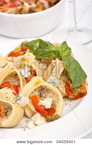 plate of stuffed shell pasta baked with cheese and tomato sauce
