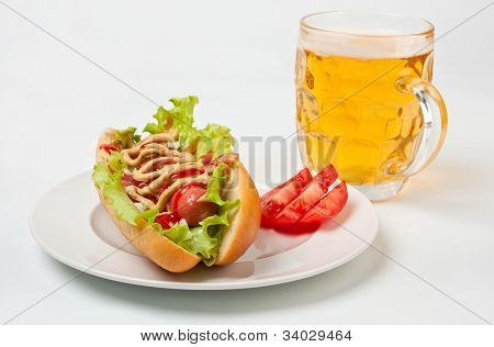 chicago hotdog and glass of beer
