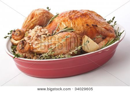 whole roasted stuffed turkey in a dish