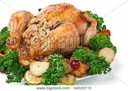 whole roasted stuffed chicken with parsley, vegetables and cranberries
