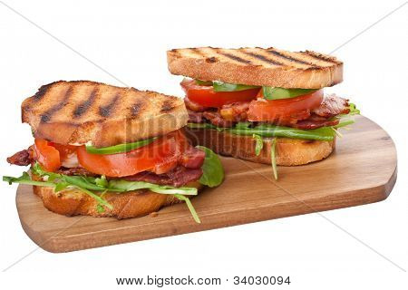 Bacon, lettuce and tomato BLT sandwiches  on a cutting board