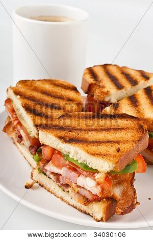 Bacon, lettuce and tomato BLT sandwiches  on a plate and a cup of coffee