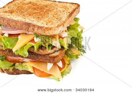 meat, lettuce , cheese and egg salad big sandwich on toasted bread