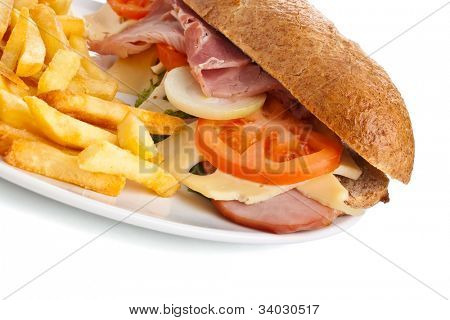 plate with whole wheat stuffed with meat, cheese and vegetables sandwich and french fries on white background