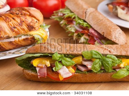 big group of sandwiches on a table