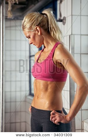 Portrait Of Sporty Woman In Gym