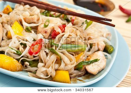 Serving of oriental warm noodle chicken salad