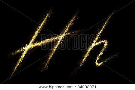 "Letter ""H"" of gold glittering stars dust trail (glittering font concept)"