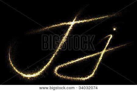 """Letter """"J"""" of gold glittering stars dust trail (glittering font concept)"""