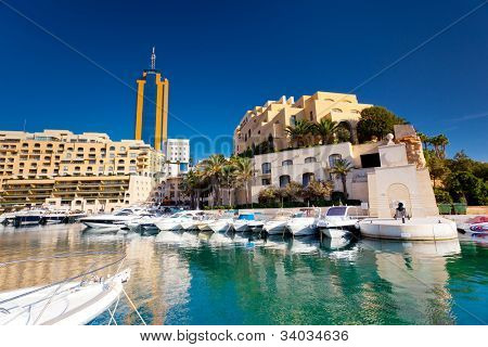 Fantastic city landscape on the seaside with boats. Portomaso Business Tower, Malta.