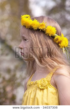 Profile Portrait Of Little Girl In Dandelion Wreath