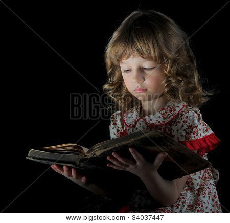 Teen girl reading the Book.