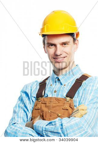 Smiling young happy builder worker portrait in protective hardhat and workwear overall isolated