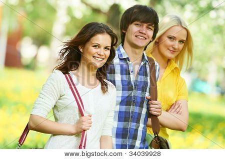 young students group of three people in spring outdoors