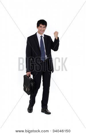 Young businessman celebrating promotion