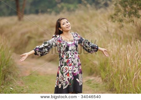 woman breathing in wild nature scenery, thailand