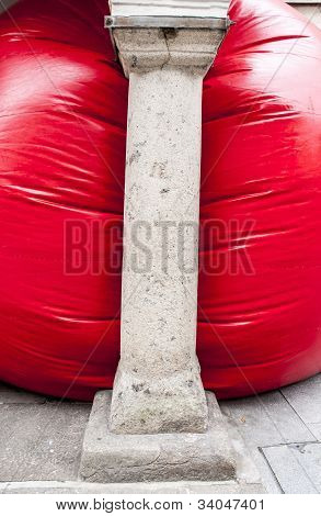 Kurt Perschke's giant Red Ball that was squeezed into the entrance of the Guildhall
