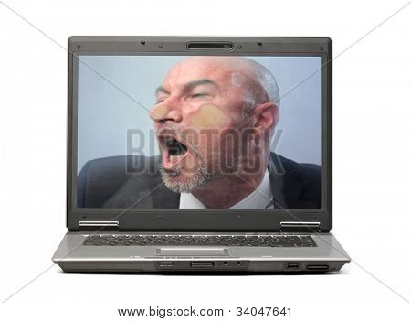 Businessman trapped into a laptop screen with his face squashed on it