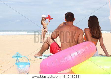 Family at the beach together