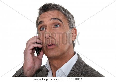 Surprised man looking at a screen