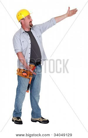 Tradesman presenting an invisible object
