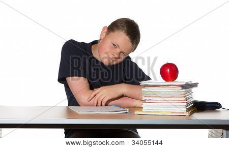 Teenager With Pile Of Books And An Apple