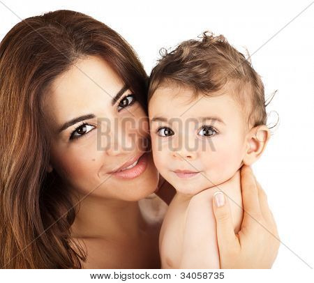 Cute baby boy smiling with mother, closeup on happy family faces, mom and kid having fun indoor, parent holding little child in hands, healthy toddler and mommy portrait isolated on white background