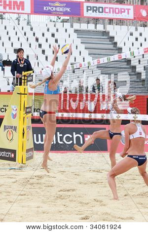 MOSCOW, RUSSIA - JUNE 8: Jennifer Kessy (left) and April Ross, USA vs Emilia (right) and Erika (center) Nystrom, Finland, during Beach Volleyball Swatch World Tour in Moscow, Russia at June 8, 2012