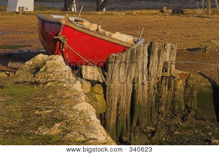 Red Rowing Boat Berthed On Land