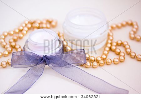 Luxury Spa Products And Gold Beaded Necklace