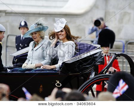 LONDON, UK - JUNE 16: The Duchess of Cambridge, the Duchess of Cornwall and Prince Harry during Trooping the Colour ceremony, on June 16, 2012 in London.