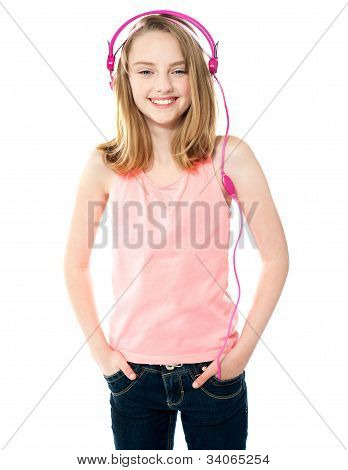 Pretty Girl Enjoying Music Through Headphones