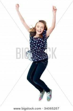 Young Girl Jumping In Excitement