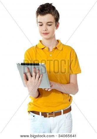 Portrait Of A Cute Boy Using A Portable Device