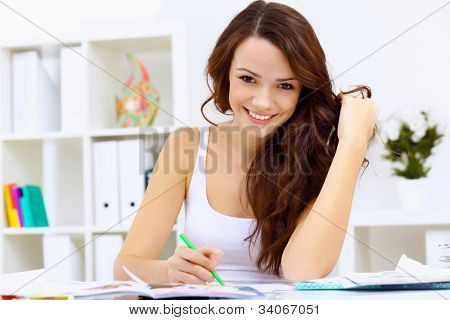 Student girl studying her lessons at home