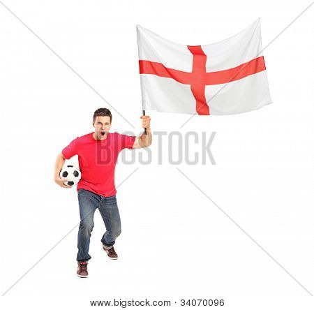 Full length portrait of an euphoric fan holding a ball and English flag isolated on white background