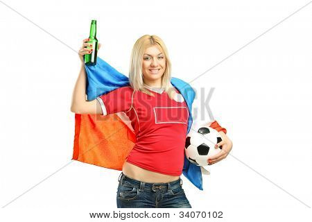 Full length portrait of a happy female fan holding a beer bottle and football isolated on white background