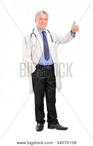 Full length portrait of a smiling mature healthcare professional giving a thumb up isolated on white background