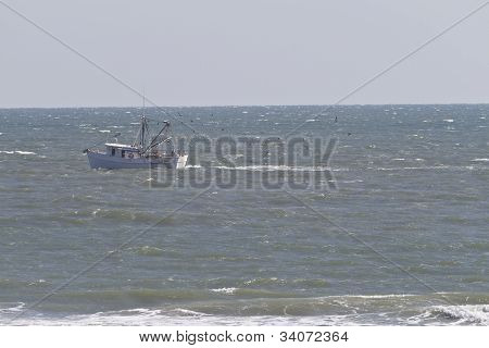 Commercial Trawler Out On A Choppy Sea