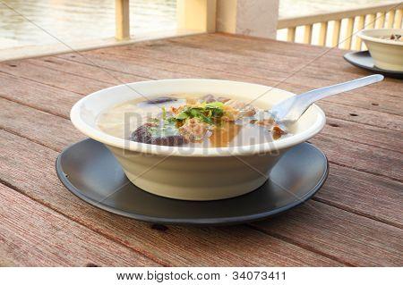 Pork and mushroom congee on morning breakfast.