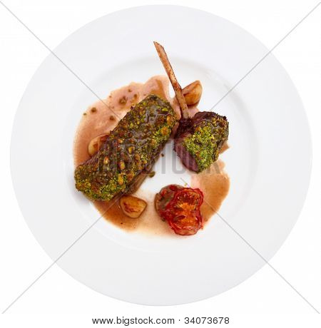 Grilled rack of lamb with mint and pistachio, isolated on white background