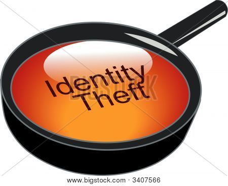 Magnifying Glass Over Identity Theft Button.