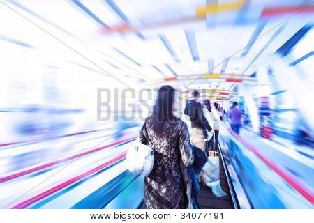 moving escalator with people in big mall