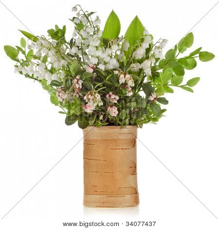 bouquet of lilies-of-the-valley with bloom blueberries cowberries on birch vase