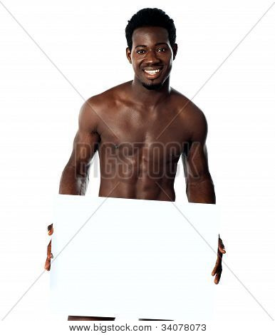 Young Muscular Man Holding Blank Billboard