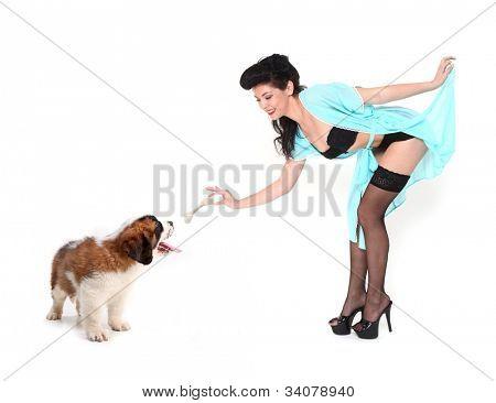 Cute Pinup Girl Giving Saint Bernard a Treat