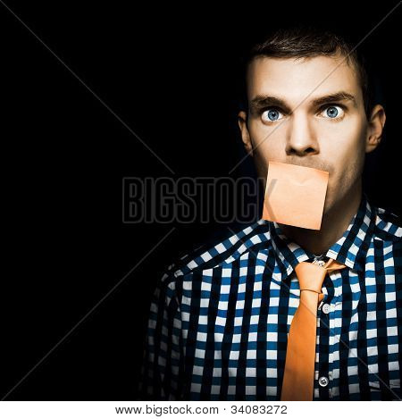 Male Office Worker With Blank Orange Sticky Note