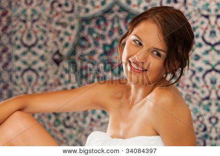 Young woman enjoys a wellness steam bath in a thermal bath