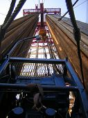 foto of oil rig  - this is a picture of drill pipe looking upwards on an oil - JPG
